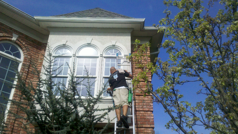 cleaning a residential window - brighter window cleaning